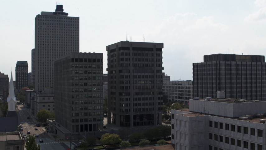5.7K stock footage aerial video descend by a county building and police station in Downtown Memphis, Tennessee Aerial Stock Footage | DX0002_184_015