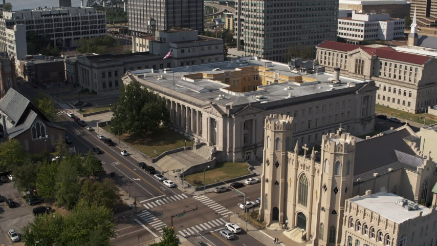 5.7K stock footage aerial video fly away from courthouse, reveal church in Downtown Memphis, Tennessee Aerial Stock Footage | DX0002_184_020