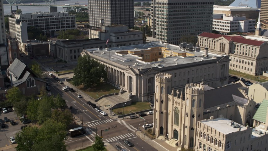 5.7K stock footage aerial video focus on courthouse while orbiting near the church in Downtown Memphis, Tennessee Aerial Stock Footage | DX0002_184_021