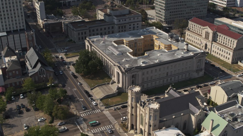 5.7K stock footage aerial video reverse view of courthouse by a church, Downtown Memphis, Tennessee Aerial Stock Footage | DX0002_184_024