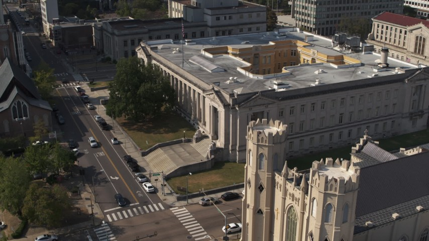 5.7K stock footage aerial video focus on courthouse and descend by church in Downtown Memphis, Tennessee Aerial Stock Footage | DX0002_184_027