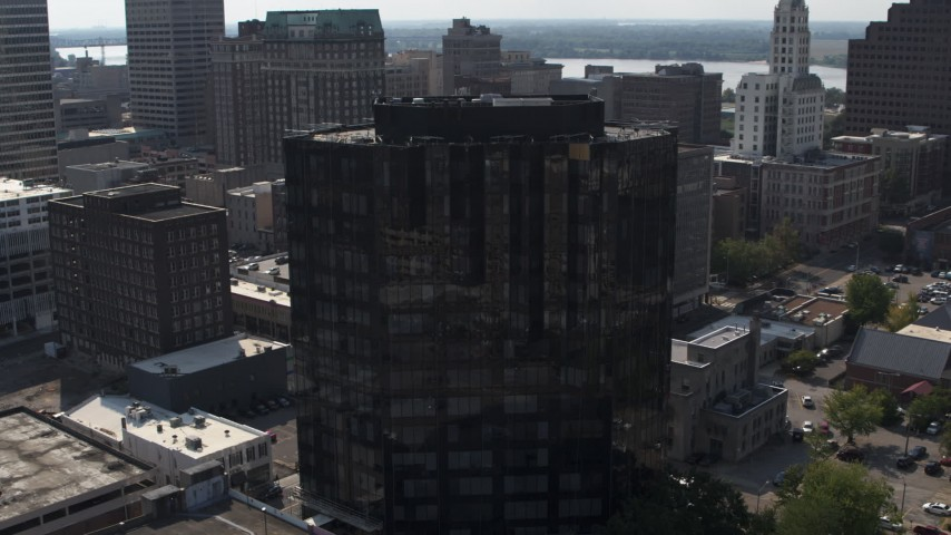 5.7K stock footage aerial video of flying away from courthouse and office building in Downtown Memphis, Tennessee Aerial Stock Footage | DX0002_184_030
