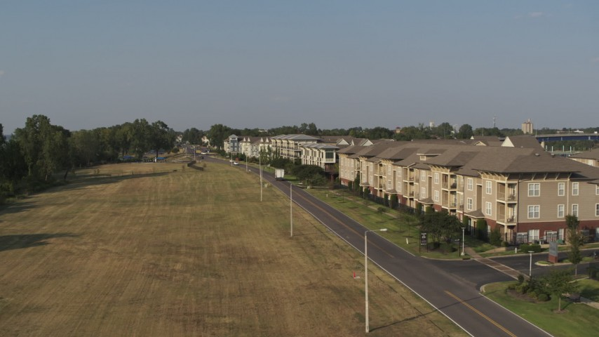 5.7K stock footage aerial video of flying low past apartment buildings in Memphis, Tennessee Aerial Stock Footage | DX0002_185_001