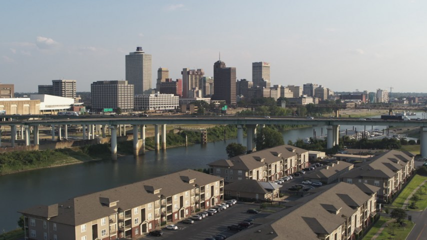 5.7K stock footage aerial video of the city's skyline and bridge seen from apartment buildings, Downtown Memphis, Tennessee Aerial Stock Footage | DX0002_185_003