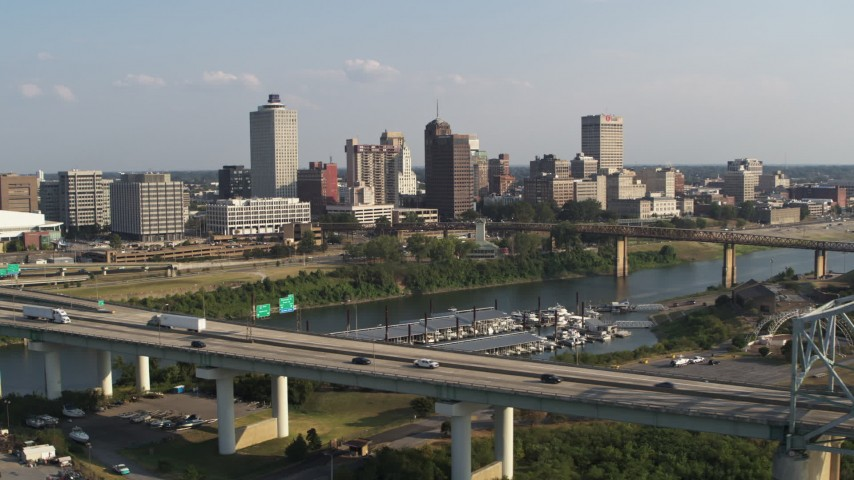 5.7K stock footage aerial video focus on skyline while flying by the bridge, Downtown Memphis, Tennessee Aerial Stock Footage | DX0002_185_005