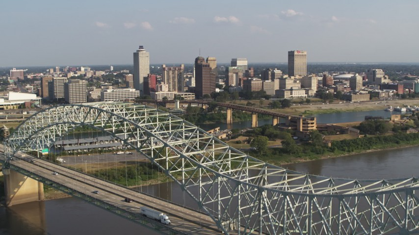 5.7K stock footage aerial video focus on skyline while descending by the bridge, Downtown Memphis, Tennessee Aerial Stock Footage | DX0002_185_007
