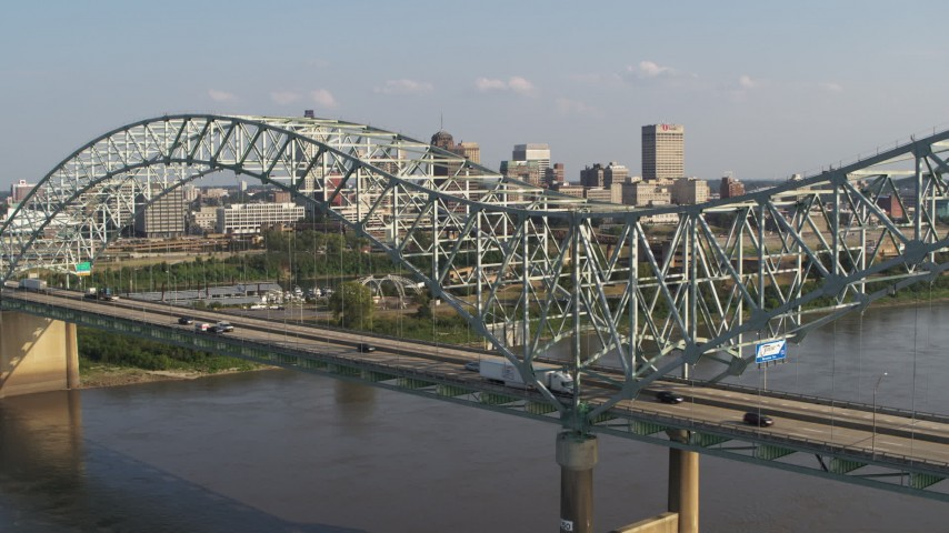 5.7K stock footage aerial video of a stationary view of traffic crossing the bridge near Downtown Memphis, Tennessee Aerial Stock Footage | DX0002_185_008