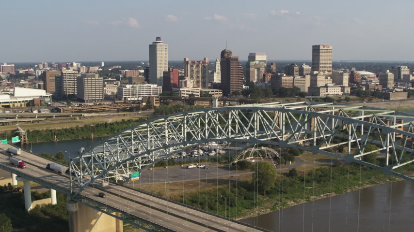 5.7K stock footage aerial video ascend past bridge for view of the skyline, Downtown Memphis, Tennessee Aerial Stock Footage | DX0002_185_011