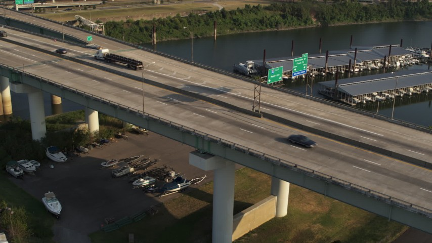 5.7K stock footage aerial video of cars and trucks on the Tennessee side of the bridge in Memphis Aerial Stock Footage | DX0002_185_015