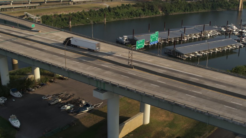 5.7K stock footage aerial video of a stationary view of cars and trucks on the bridge in Memphis, Tennessee Aerial Stock Footage | DX0002_185_017