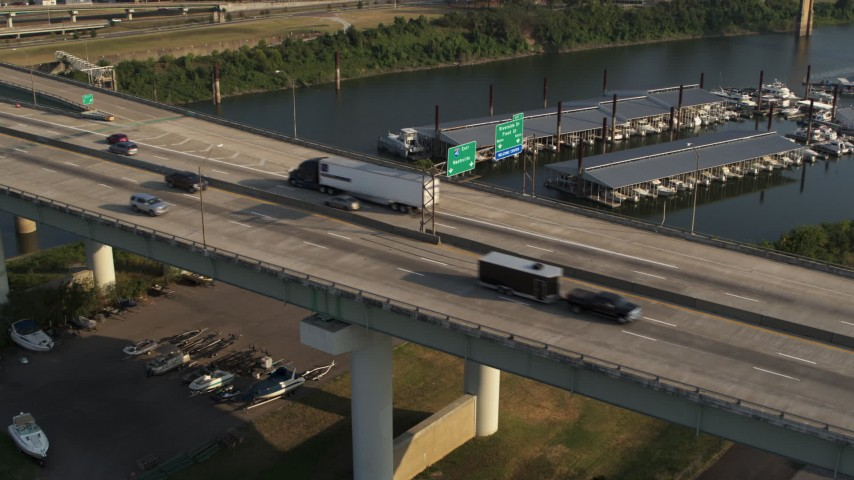 5.7K stock footage aerial video of a static view of cars and trucks on the bridge in Memphis, Tennessee Aerial Stock Footage | DX0002_185_018