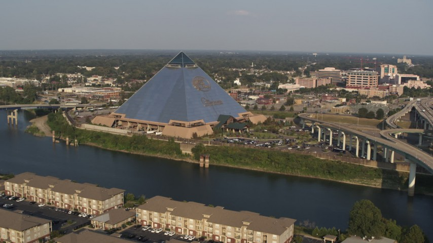 5.7K stock footage aerial video of approaching the Memphis Pyramid from bridge, Downtown Memphis, Tennessee Aerial Stock Footage | DX0002_185_020