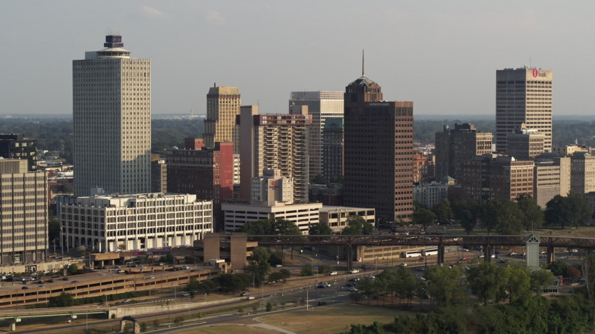 5.7K stock footage aerial video of a reverse view of the skyline at sunset, Downtown Memphis, Tennessee Aerial Stock Footage | DX0002_185_027