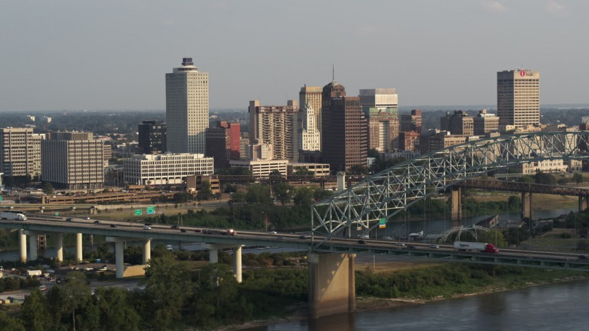 5.7K stock footage aerial video of approaching the skyline behind the bridge at sunset, Downtown Memphis, Tennessee Aerial Stock Footage | DX0002_185_030