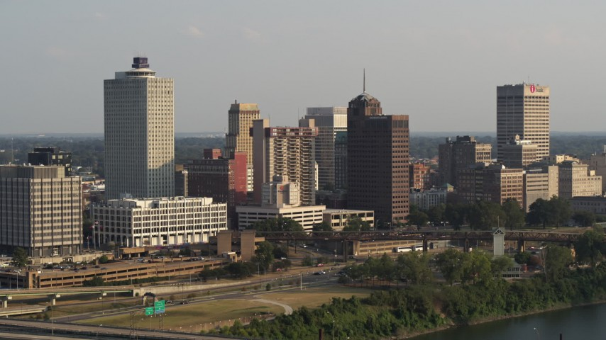 5.7K stock footage aerial video of flying away from the downtown skyline at sunset, Downtown Memphis, Tennessee Aerial Stock Footage | DX0002_185_032