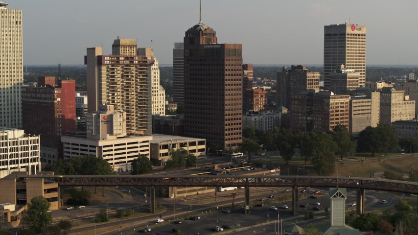 5.7K stock footage aerial video of circling an apartment complex and office tower at sunset, Downtown Memphis, Tennessee Aerial Stock Footage | DX0002_185_039