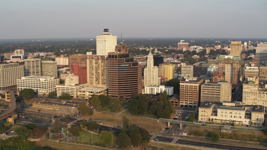 5.7K stock footage aerial video orbit and fly away from downtown buildings at sunset, Downtown Memphis, Tennessee Aerial Stock Footage | DX0002_186_002