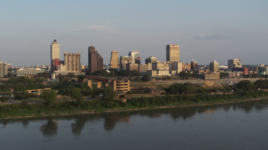 5.7K stock footage aerial video orbit and approach museum at sunset, skyline in distance, Downtown Memphis, Tennessee Aerial Stock Footage DX0002_186_015 | Axiom Images