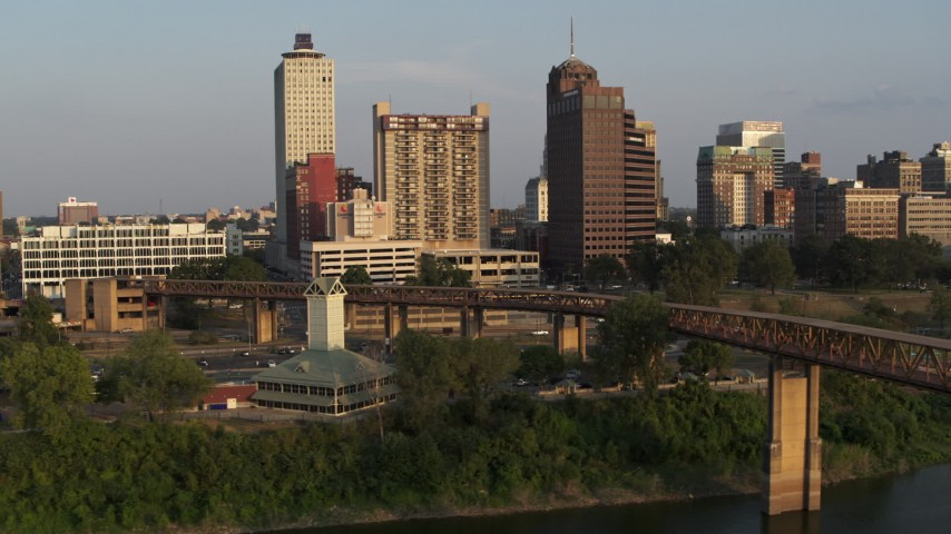 5.7K stock footage aerial video orbit welcome center, bridge, apartment complex and office tower at sunset, Downtown Memphis, Tennessee Aerial Stock Footage | DX0002_186_017