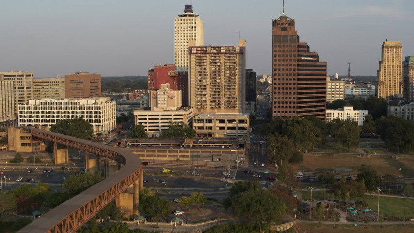 5.7K stock footage aerial video orbit apartment complex and neighboring office tower at sunset, Downtown Memphis, Tennessee Aerial Stock Footage | DX0002_186_018