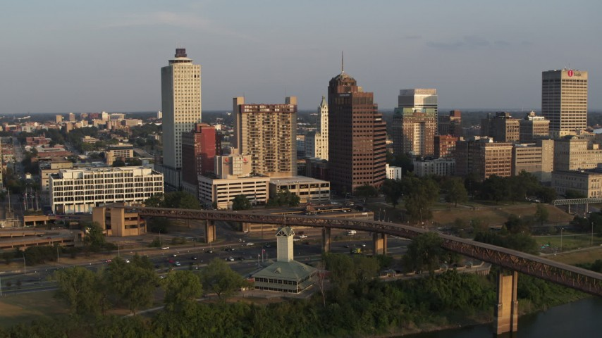 5.7K stock footage aerial video reverse view of apartment complex and neighboring office tower at sunset, Downtown Memphis, Tennessee Aerial Stock Footage | DX0002_186_019