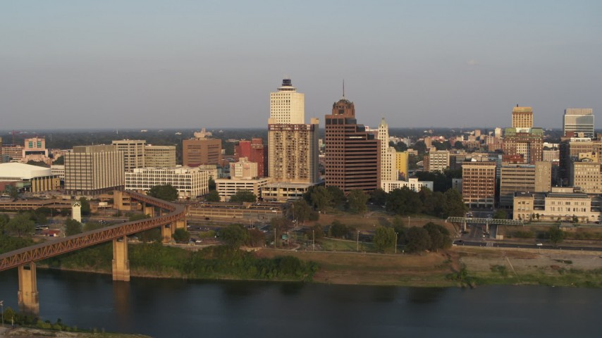 5.7K stock footage aerial video of apartment complex and neighboring office tower by bridge at sunset, Downtown Memphis, Tennessee Aerial Stock Footage | DX0002_186_020