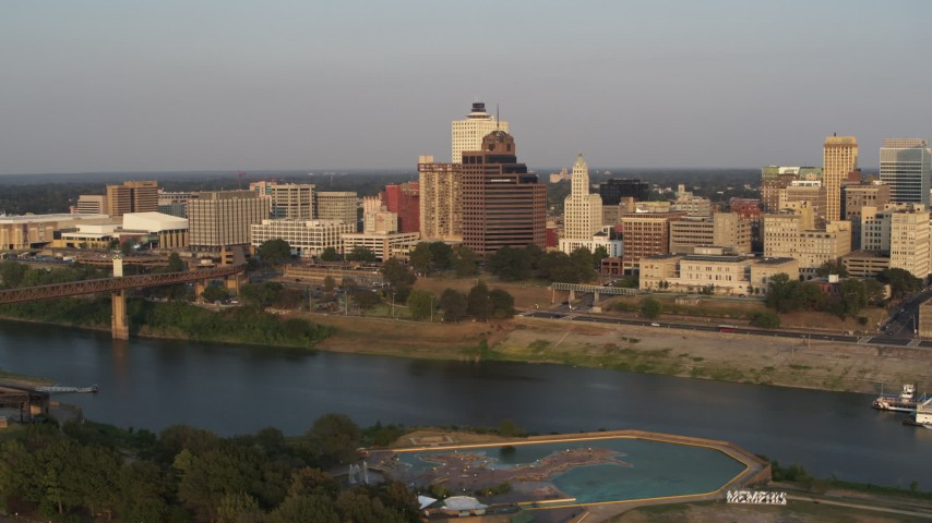 5.7K stock footage aerial video orbit apartment and office towers across river at sunset, Downtown Memphis, Tennessee Aerial Stock Footage | DX0002_186_022