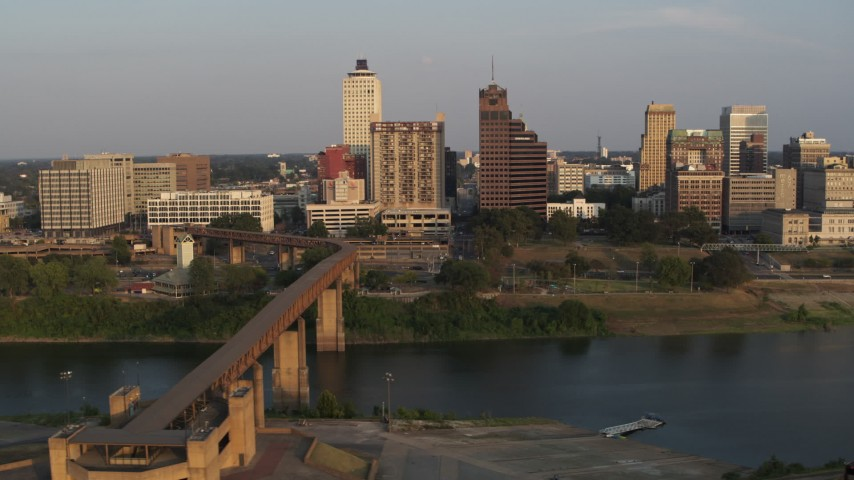 5.7K stock footage aerial video of the welcome center, bridge, apartment complex and office tower at sunset, Downtown Memphis, Tennessee Aerial Stock Footage | DX0002_186_023