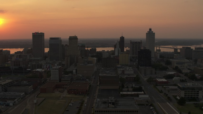 5.7K stock footage aerial video orbit the city skyline and reveal setting sun, Downtown Memphis, Tennessee Aerial Stock Footage | DX0002_186_025
