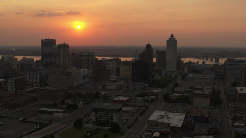 5.7K stock footage aerial video orbit the city skyline and the setting sun, Downtown Memphis, Tennessee Aerial Stock Footage | DX0002_186_026