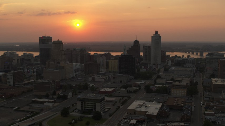5.7K stock footage aerial video orbit the downtown skyline and the setting sun, Downtown Memphis, Tennessee Aerial Stock Footage | DX0002_186_027