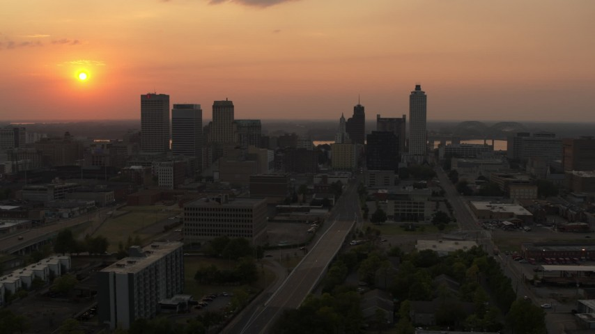 5.7K stock footage aerial video a reverse view of the downtown skyline and the setting sun, Downtown Memphis, Tennessee Aerial Stock Footage | DX0002_186_028