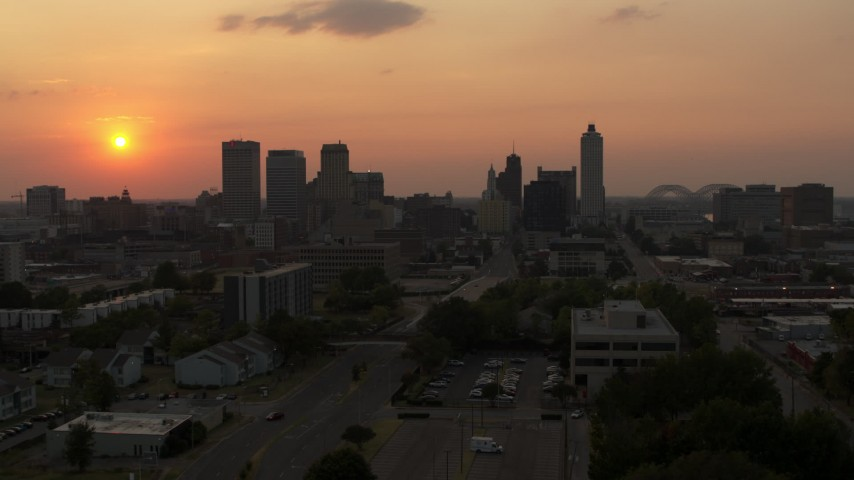 5.7K stock footage aerial video of approaching the downtown skyline and the setting sun, Downtown Memphis, Tennessee Aerial Stock Footage | DX0002_186_029