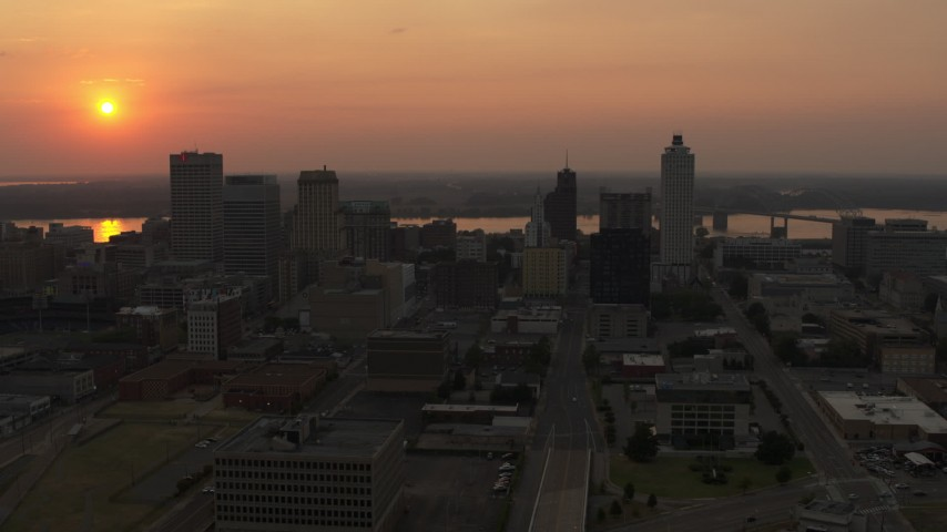 5.7K stock footage aerial video of flying toward the downtown skyline and the setting sun, Downtown Memphis, Tennessee Aerial Stock Footage | DX0002_186_030