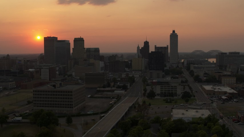5.7K stock footage aerial video fly away from the downtown skyline and the setting sun, then descent, Downtown Memphis, Tennessee Aerial Stock Footage | DX0002_186_031