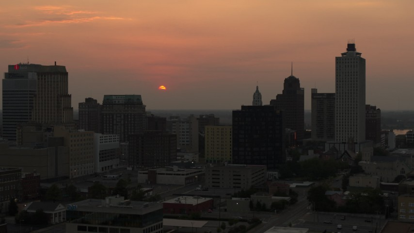 5.7K stock footage aerial video orbit office towers with view of setting sun, Downtown Memphis, Tennessee Aerial Stock Footage | DX0002_186_032