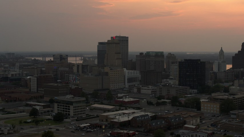 5.7K stock footage aerial video of office high-rises with the setting sun in the sky, Downtown Memphis, Tennessee Aerial Stock Footage | DX0002_186_034