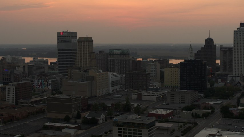 5.7K stock footage aerial video of the skyline as the setting sun disappears in the sky, Downtown Memphis, Tennessee Aerial Stock Footage | DX0002_186_035