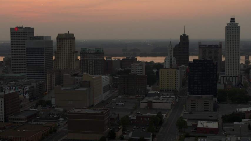5.7K stock footage aerial video an orbit of the office towers of the skyline at sunset, Downtown Memphis, Tennessee Aerial Stock Footage | DX0002_186_036