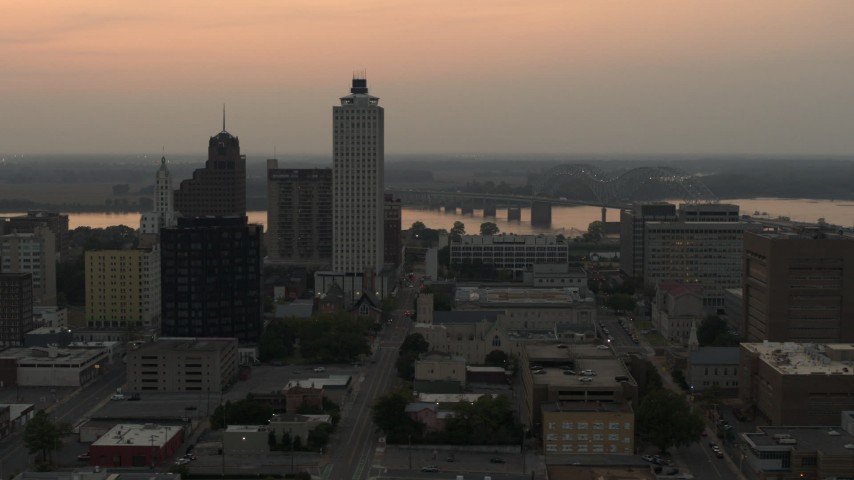 5.7K stock footage aerial video flyby office towers at sunset, with view of river and bridge, Downtown Memphis, Tennessee Aerial Stock Footage | DX0002_186_037