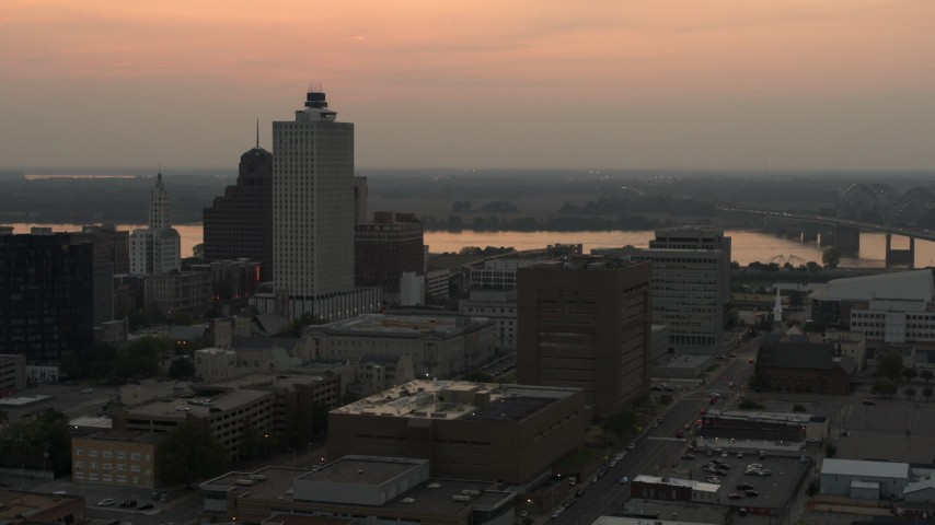 5.7K stock footage aerial video flyby and away from office towers at sunset, with view of river, Downtown Memphis, Tennessee Aerial Stock Footage | DX0002_186_038