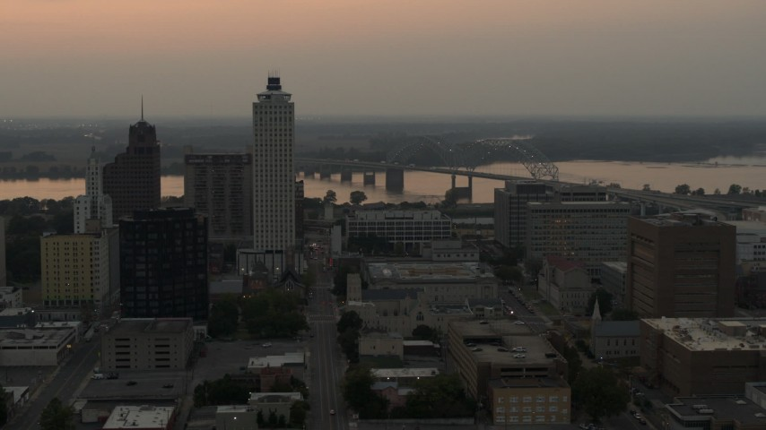 5.7K stock footage aerial video orbit office towers at sunset, with view of river and bridge, Downtown Memphis, Tennessee Aerial Stock Footage | DX0002_186_039