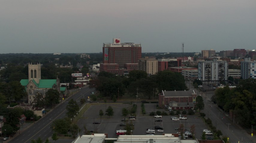 5.7K stock footage aerial video a view of a hospital at twilight during descent in Memphis, Tennessee Aerial Stock Footage | DX0002_186_045