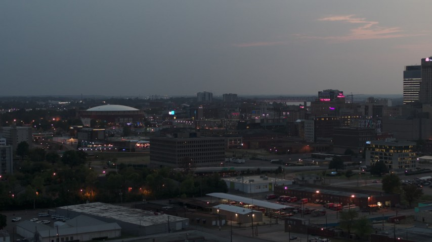 5.7K stock footage aerial video of city buildings and FedEx Forum at twilight, Downtown Memphis, Tennessee Aerial Stock Footage | DX0002_187_001
