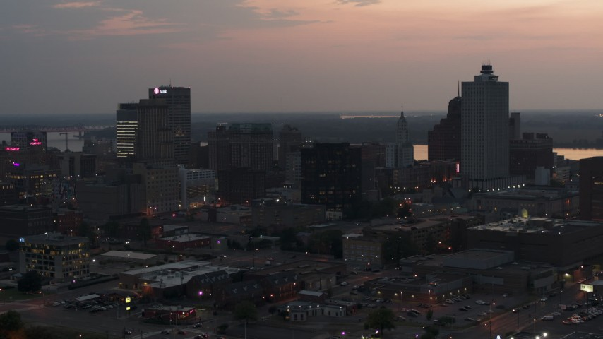 5.7K stock footage aerial video of a reverse view of the city's downtown skyline at twilight, Downtown Memphis, Tennessee Aerial Stock Footage | DX0002_187_003