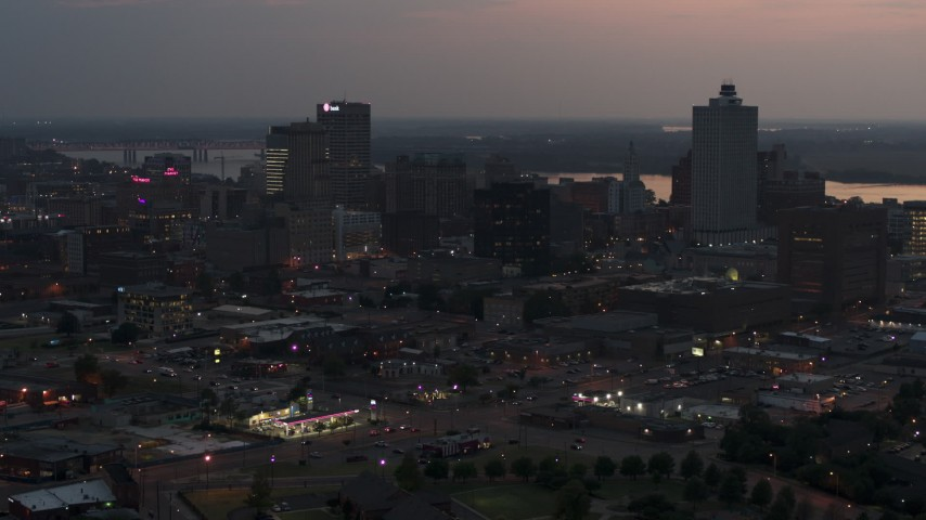 5.7K stock footage aerial video of flying away from the city's downtown skyline at twilight, Downtown Memphis, Tennessee Aerial Stock Footage | DX0002_187_004