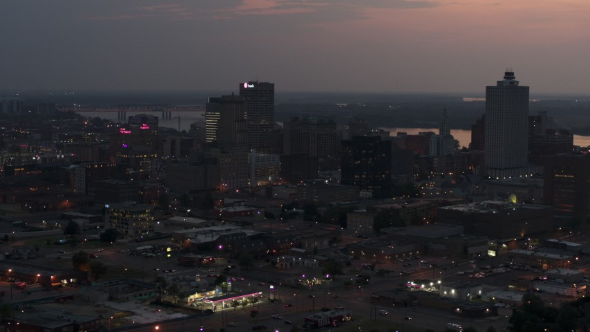 5.7K stock footage aerial video of approaching the city's downtown skyline at twilight, Downtown Memphis, Tennessee Aerial Stock Footage | DX0002_187_005