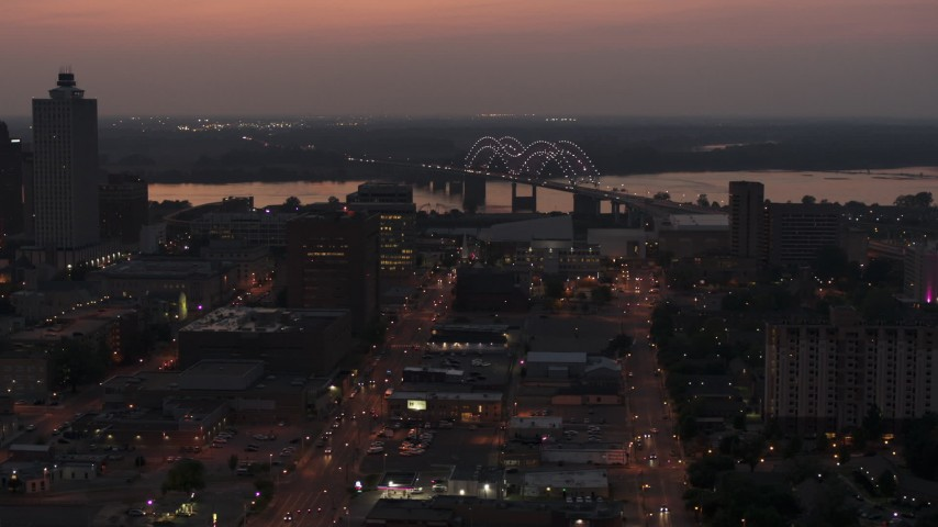 5.7K stock footage aerial video orbit Hernando de Soto Bridge, seen from Downtown Memphis, Tennessee at twilight Aerial Stock Footage | DX0002_187_008
