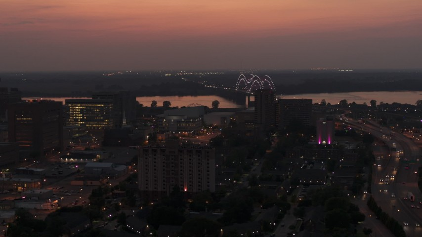 5.7K stock footage aerial video a view of the Hernando de Soto Bridge, seen from Downtown Memphis, Tennessee at twilight Aerial Stock Footage | DX0002_187_011