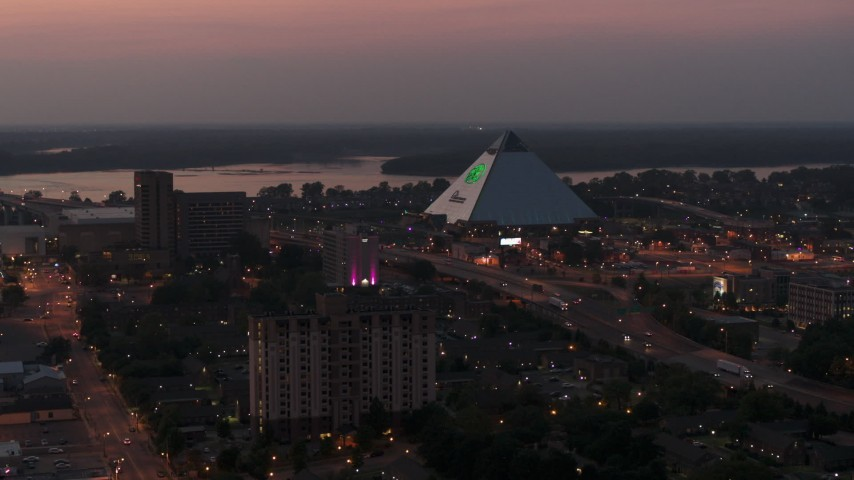 5.7K stock footage aerial video a stationary view of the Memphis Pyramid at twilight, Downtown Memphis, Tennessee Aerial Stock Footage | DX0002_187_012